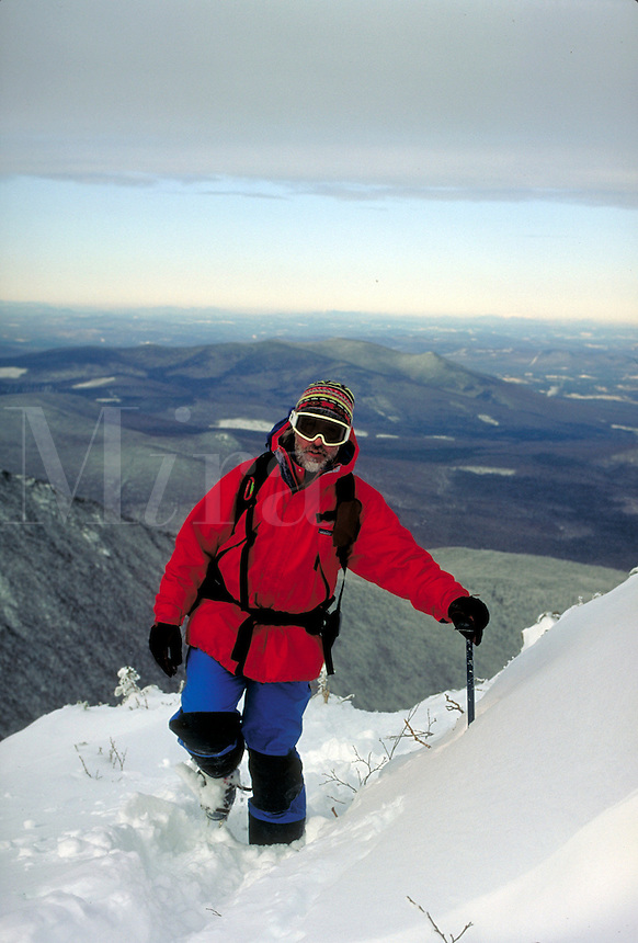 Winter mountain climber approaching Edmunds Col in the Northern Presidential range of the White Mountains of NH. This location is well above 5,000 feet in elevation and subject to extreme high winds and low temperatures. Bill McDonald. White Mountains NH