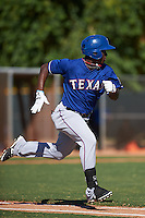 Texas Rangers Chad Smith (12) during an instructional league game against the San Diego Padres on October 9, 2015 at the Surprise Stadium Training Complex in Surprise, Arizona.  (Mike Janes/Four Seam Images)