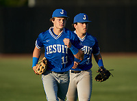 Jesuit Tigers outfielders Wes Mendes (11) and AJ Nessler (5) jog to the dugout during a game against the IMG Academy Ascenders on April 21, 2021 at IMG Academy in Bradenton, Florida.  (Mike Janes/Four Seam Images)