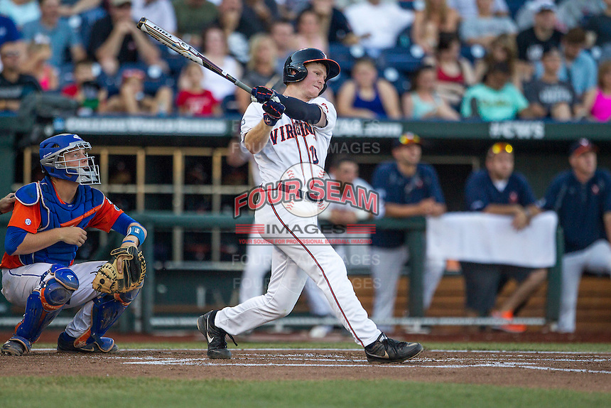 Virginia Cavaliers first baseman Pavin Smith (10) follows through on his swing against the Florida Gators in Game 13 of the NCAA College World Series on June 20, 2015 at TD Ameritrade Park in Omaha, Nebraska. The Cavaliers beat the Gators 5-4. (Andrew Woolley/Four Seam Images)