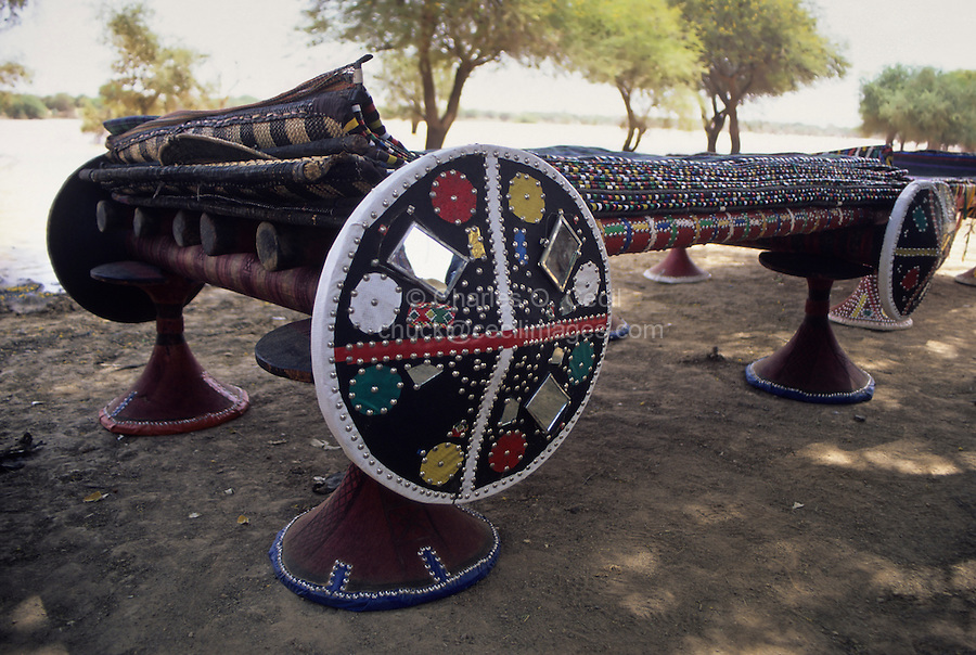 Akadaney, Central Niger, West Africa.  Fulani Nomads.  Portable Bed, with Numerous Mats on Top.