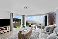 BNPS.co.uk (01202) 558833. <br /> Pic: ScottParry/BNPS<br /> <br /> Pictured: Living room. <br /> <br /> Life's a beach...<br /> <br /> A coastal clifftop home above a picturesque Cornish beach is on the market for £1.75m.<br /> <br /> High Seas sits in a prime position above Millendreath Beach in Looe, the 'Cornish Riviera', with spectacular views across Whitsand Bay and out to sea.<br /> <br /> The impressive five-bedroom property has almost 5,000 sq ft of living space and a decent sized garden, but it's real draw is its location.<br /> <br /> The house is 150 yards from Millendreath Beach and its garden gate will take the owners straight onto the South West Coast Path.