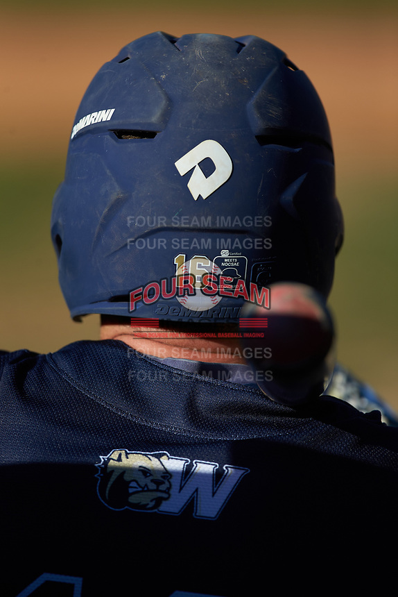 Colby Barnette (16) of the Wingate Bulldogs waits for his turn to bat during the game against the Catawba Indians at Newman Park on March 19, 2017 in Salisbury, North Carolina. The Indians defeated the Bulldogs 12-6. (Brian Westerholt/Four Seam Images)