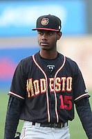 Raimel Tapia (15) of the Modesto Nuts before a game against the Rancho Cucamonga Quakes at LoanMart Field on May 39, 2015 in Rancho Cucamonga, California. Rancho Cucamonga defeated Modesto, 13-2. (Larry Goren/Four Seam Images)