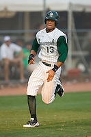 Carlos Guzman (13) of the Savannah Sand Gnats scores a run during the first inning of play at Grayson Stadium in Savannah, GA, Wednesday August 6, 2008  (Photo by Brian Westerholt / Four Seam Images)