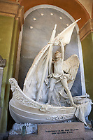 "Picture and image of the stone sculpture ""L'Angelo Nocchiero"" (the Helmsman Angel). The sculpture depicts an angel, standing astride a small boat, beginning to secure the sails at the end of a journey. His garments are streaming behind him, suggesting a strong wind. The prow of the boat is the stoic face of a woman, and under the prow the water swirls. The Giacomo Carpaneto tomb  sculpted by Giovanni Scanzi in 1886. Section A, no 25, monumental tombs of the Staglieno Monumental Cemetery, Genoa, Italy"