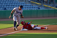 Clearwater Threshers Yhoswar Garcia (9) steals third base as Andres Chaparro (24) attempts the tag during a game against the Tampa Tarpons on June 10, 2021 at BayCare Ballpark in Clearwater, Florida.  (Mike Janes/Four Seam Images)