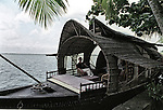 A tourist on a houseboat in Alleppey, Kerala, India.