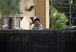 An Egyptian soldier stand guard during An Ambulance carry the body of Palestinian Ishaq Hassan, 28, who was killed by Egyptian soldiers after swimming into Egyptian waters, arrives from the Egyptian side of Rafah border crossing at the southern Gaza Strip, on Dec. 31, 2015. Egyptian authorities opened the tightly controlled Rafah Crossing to let the corpse of the Palestinian man killed by Egyptian soldiers into the Gaza Strip. Hassan's family have said he was attempting to reach Egyptian hospitals in order to receive treatment for a disease that could not be treated in Gaza. Photo by Abed Rahim Khatib