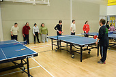 Table tennis training at the Monday Night Club, a sports session at Talacre Sports Centre, Camden, for adults with physical or learning disabilities.