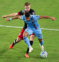 WASHINGTON, DC - SEPTEMBER 06: Julian Gressel #31 of D.C. United fights for the ball with Ismael Tajouri-Shradi #29 of New York City FC during a game between New York City FC and D.C. United at Audi Field on September 06, 2020 in Washington, DC.