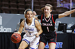 SIOUX FALLS, SD - MARCH 6: Lindsey Theuninck #3 of the South Dakota State Jackrabbits drives past Sarah Schmitt #1 of the Omaha Mavericks during the Summit League Basketball Tournament at the Sanford Pentagon in Sioux Falls, SD. (Photo by Richard Carlson/Inertia)