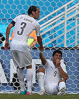 Luis Suarez of Uruguay is helped to his feet after allegedly biting Giorgio Chiellini of Italy (not pictured)
