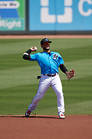 Miami Marlins shortstop Isan Díaz (1) throws to first base during a Major League Spring Training game against the Houston Astros on March 21, 2021 at Roger Dean Stadium in Jupiter, Florida.  (Mike Janes/Four Seam Images)