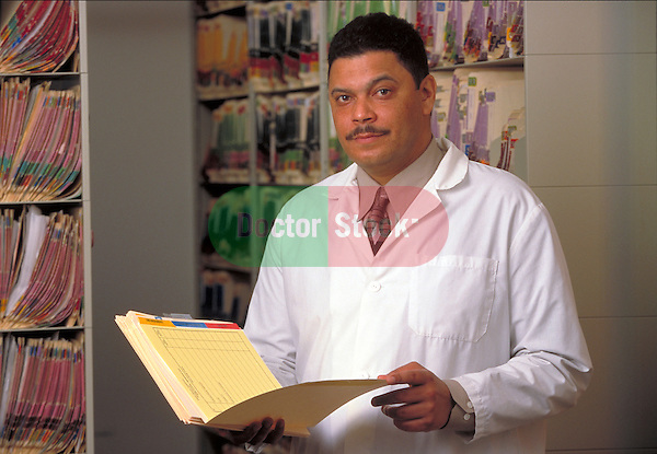 portrait of serious doctor reading medical records
