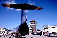 Military Aircraft on Static Display near Air Traffic Control Tower - at Abbotsford International Airshow, BC, British Columbia, Canada