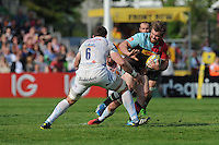 Jack Clifford of Harlequins looks to hand off David Ewers of Exeter Chiefs during the Aviva Premiership match between Harlequins and Exeter Chiefs at The Twickenham Stoop on Saturday 7th May 2016 (Photo: Rob Munro/Stewart Communications)
