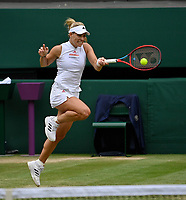 """5th July 2021, Wimbledon, SW London, England;  2021 Wimbledon Championships Angelique Kerber , Germany returns to Cori """"Coco"""" Gauff of USA in the round of 16"""
