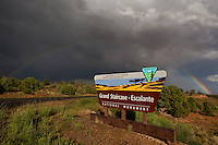 792800276 a rainbow forms during a summer monsoon rainstorm frames a blm sign for escalante grand staircase national monument in southern utah
