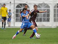 El Salvador forward Rafael Burgos (8) shields the ball against Venezuela forward Fernando Aristeguieta (9). El Salvador National Team defeated Venezuela 3-2 in an international friendly at RFK Stadium, Sunday August 7, 2011.