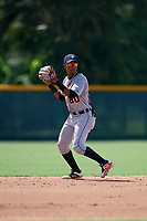 Detroit Tigers shortstop Wenceel Perez (80) throws to first base during a Florida Instructional League game against the Pittsburgh Pirates on October 2, 2018 at the Pirate City in Bradenton, Florida.  (Mike Janes/Four Seam Images)