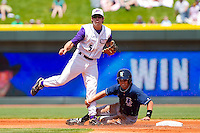 Daniel Wagner #5 of the Winston-Salem Dash turns a double play as Whit Merrifield #13 of the Wilmington Blue Rocks slides into second base at BB&T Ballpark on April 24, 2011 in Winston-Salem, North Carolina.   Photo by Brian Westerholt / Four Seam Images