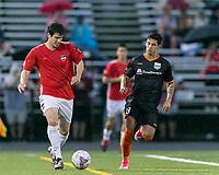 Malden, Massachusetts - July 8, 2017: In a  National Premier Soccer League (NPSL) match, Boston City FC (white/red) defeated Kingston Stockade (black), 2-0, at Brother Gilbert Stadium on Donovan Field.
