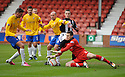 Cowdenbeath keeper Thomas Flynn gets a knock in the head as he goes down at the feet of Pars' Ryan Wallace .... Flynn later had to go off ...