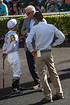 Pre-race strategy. Jockey Javier Castellano and trainer Todd Pletcher discuss while assistant trainer Anthony Sciametta looks on at Gulfstream Park, Hallandale Beach Florida. 01-11-2014