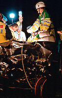 Firefighters, paramedics and doctors fight to save the life of a  driver of a car that crashed into the side of an articulated lorry. Firefighters have lit the area with portable lighting so as an operation can be performed...© SHOUT. THIS PICTURE MUST ONLY BE USED TO ILLUSTRATE THE EMERGENCY SERVICES IN A POSITIVE MANNER. CONTACT JOHN CALLAN. Exact date unknown.john@shoutpictures.com.www.shoutpictures.com..
