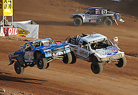 Dec. 11, 2011; Chandler, AZ, USA; LOORRS pro two unlimited driver Robby Woods (left) makes contact in the air with Carl Renezeder during the Lucas Oil Challenge Cup at Firebird International Raceway. Mandatory Credit: Mark J. Rebilas-