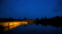 Angkor Wat at twilight the moat been lit by passing traffic from the road. Now that is not possible anymore since the road has been blocked and closed off for all traffic.
