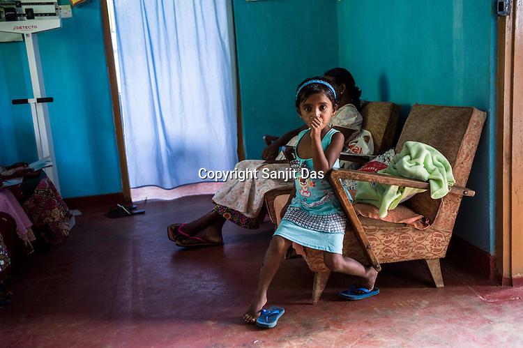 Tea plantation workers visit the local dispensary and health clinic in Eskdale Tea Estate in Nuwareliya in Central Sri Lanka.  Photo: Sanjit Das/Panos