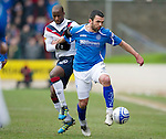 St Johnstone v Rangers...14.01.12  .Callum Davidson holds off Sone Aluko.Picture by Graeme Hart..Copyright Perthshire Picture Agency.Tel: 01738 623350  Mobile: 07990 594431