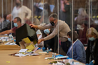 Pictured: Ballot papers are emptied onto the table during the Swansea West and South West Wales Regional Election Count at Brangwyn Hall in Swansea, Wales, UK. Friday 07 May 2020