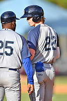 Brooklyn Cyclones third baseman Brett Baty (22) talks with first base coach Mariano Duncan (25) during a game against the Asheville Tourists on May 5, 2021 at McCormick Field in Asheville, NC. (Tony Farlow/Four Seam Images)