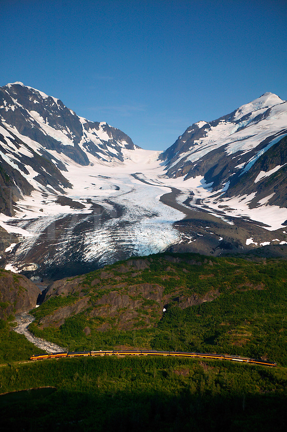 """The Alaska Railroad travels through the Chugach National Forest at the """"big curve"""" in front of the Bartlett Glacier, Alaska...July 13, 2004 Porcaro / Alaska Railroad assignment"""