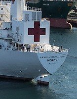 LOS ANGELES, CA - MARCH 27: The Military Sealift Command hospital ship USNS Mercy (T-AH 19) arrives in Los Angeles, Calif., March 27, 2020. Mercy deployed in support of the nation's COVID-19 response efforts, and will serve as a referral hospital for non-COVID-19 patients currently admitted to shore-based hospitals. This allows shore base hospitals to focus their efforts on COVID-19 cases. One of the Department of Defense's missions is Defense Support of Civil Authorities. DOD is supporting the Federal Emergency Management Agency, the lead federal agency, as well as state, local and public health authorities in helping protect the health and safety of the American people on March 27, 2020 in Los Angeles, California<br /> <br /> People:  USNS Mercy (T-AH 19)
