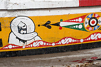 Senegal, Saint Louis.  A representation of Cheikh Ahmadu Bamba (1853-1927), founder of the Sufi Islamic Mouride Brotherhood, on the side of a fishing boat.    This most likely indicates that the owner of the boat is an adherent of the Mouride brotherhood, the most important Senegalese religious brotherhood.