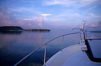 Efate island seen across the water from a boat at sunrise, Vanuatu.