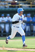 Kevin Kramer (7) of the UCLA Bruins runs to first base during a game against the Arizona Wildcats at Jackie Robinson Stadium on May 16, 2015 in Los Angeles, California. UCLA defeated Arizona, 6-0. (Larry Goren/Four Seam Images)