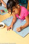 Education Preschool art activity girl drawing using left hand
