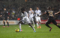 Wednesday, 01 January 2014<br /> Pictured L-R: Wilfried Bony of Swansea against Fernandinho  scores his second goal, reducing the difference to 3-2 for the visitors.<br /> Re: Barclay's Premier League, Swansea City FC v Manchester City at the Liberty Stadium, south Wales.