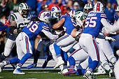 Buffalo Bills Tremaine Edmunds (49) and Matt Milano (58) tackle running back Elijah McGuire (25) at the two yard line during an NFL football game against the New York Jets, Sunday, December 9, 2018, in Orchard Park, N.Y.  (Mike Janes Photography)