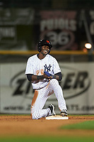Scottsdale Scorpions right fielder Estevan Florial (19), of the New York Yankees organization, laughs after being called out at second base during an Arizona Fall League game against the Peoria Javelinas on October 20, 2017 at Scottsdale Stadium in Scottsdale, Arizona. the Javelinas defeated the Scorpions 2-0. (Zachary Lucy/Four Seam Images)