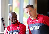 (L-R) Assistant manager Claude Makelele speaks with goalkeeping coach Tony Roberts in the gym during the Swansea City Training at The Fairwood Training Ground, Swansea, Wales, UK. Thursday 10 August 2017