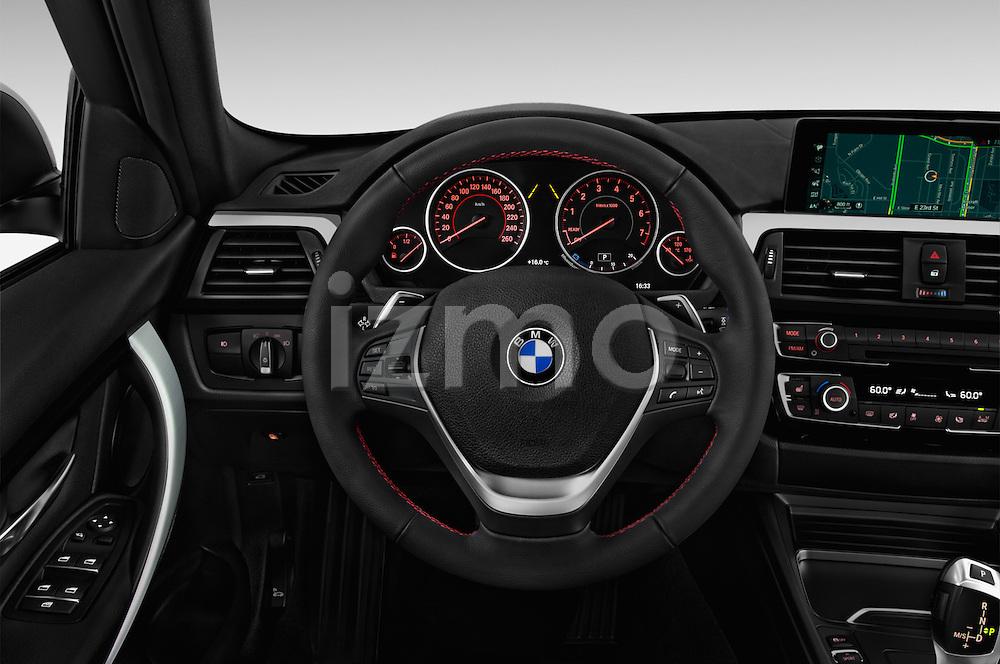 Car pictures of steering wheel view of a 2017 BMW 3-Series-Plug-In-Hybrid Sport 4 Door Sedan Steering Wheel