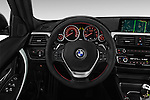 Car pictures of steering wheel view of a 2017 BMW 3-Series-Plug-In-Hybrid Sport 4 Door Sedan Steering Wheel