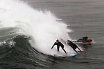 Surfer surfers surf Surfing surfboard Seal Beach California.  Photograph by Alan Mahood.