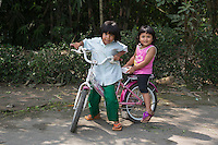 Borobudur, Java, Indonesia.  Two Young Indonesian Girls on a Bicycle.
